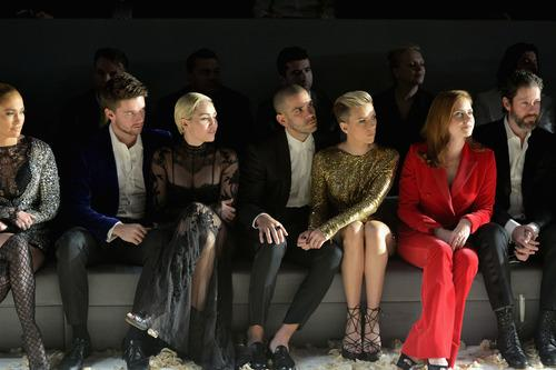 From left to right, Jennifer Lopez, Patrick Schwarzenegger, Miley Cyrus, Romain Dauriac, Scarlett Johansson, and Amy Adams sit front row at Tom Ford's FW 2015 collection. Photo: Getty Images