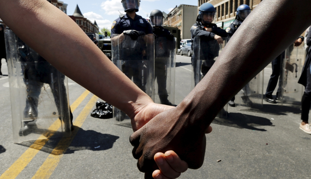 protesters-holding-hands